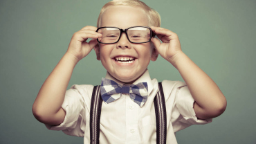child-with-glasses-370x208